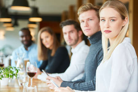 Young people in the restaurant with mobile addiction are silently silent