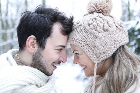 Happy couple in love is standing outside in winter Archivio Fotografico