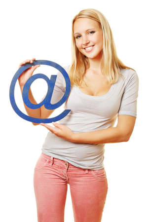 Smiling woman holding at sign symbolizing the internet