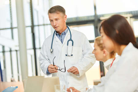 Doctor as a competent speaker in a medical workshop in the clinic or university