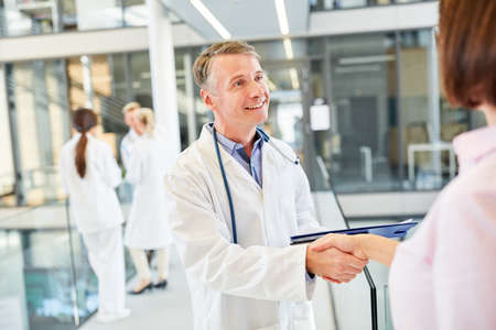 Doctor greets a patient with handshake as a greeting or thanks