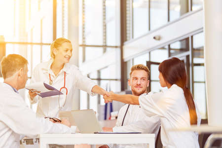 Doctors give handshake to greeting at meeting in a hospital Banque d'images