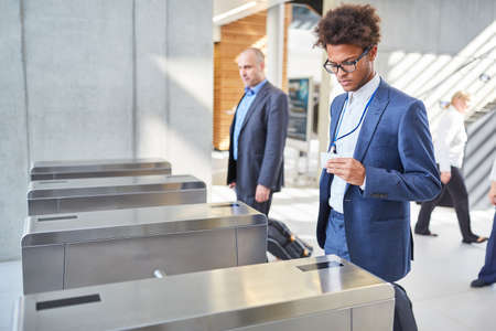 Young businessman at a security gate for access control in business