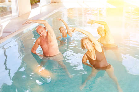 Active group seniors doing aquagym in the pool as back training Archivio Fotografico