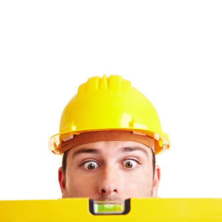 Craftsman looks in amazement at a yellow spirit level