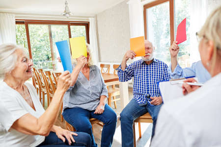 Seniors at the meeting of a group therapy with psychotherapist in the nursing home