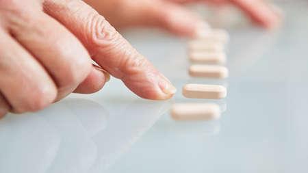 Patient points finger at tablets as a sign of drug addiction Stock fotó