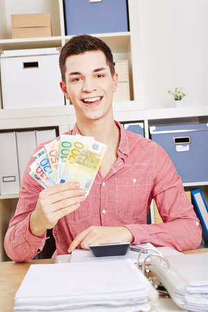 Laughing man with fan of euro banknotes in hand Stock fotó