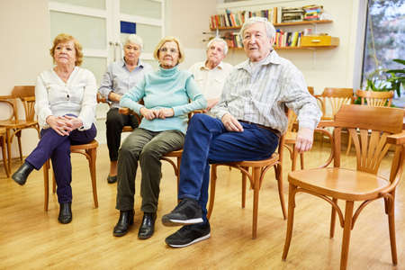 Group of seniors in the common room in the nursing home are waiting for an information evening Stock fotó