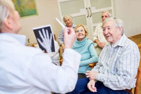Doctor makes health education for seniors in nursing home Stock fotó