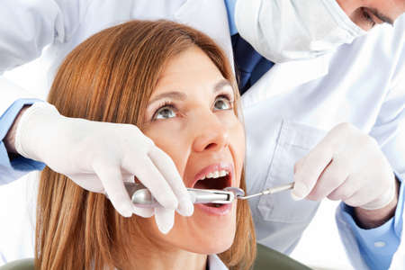 Pulling teeth at the dentist with pliers Stock fotó