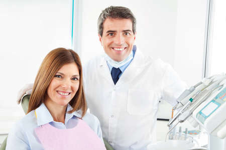 Happy woman sitting smiling at the dentist