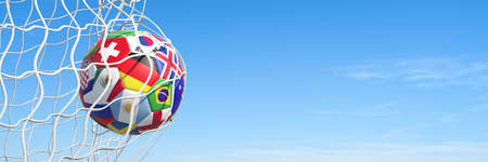Panorama view of a soccer goal scored with a ball featuring flags of various national teams (3D rendering)