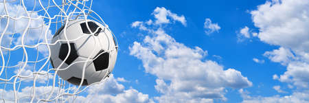 Panorama of a goal scored with a classic soccer ball with a summer sky background (3D rendering) Фото со стока