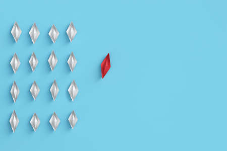 Leader in red of a group of white origami boats as a business concept (3d rendering)
