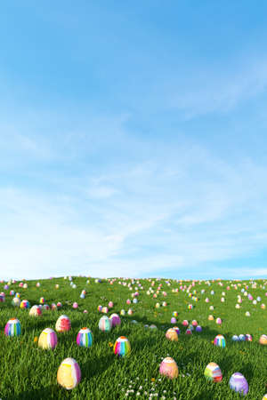 Many colorful Easter eggs lie on a meadow in front of a blue sky for Easter (3d rendering)