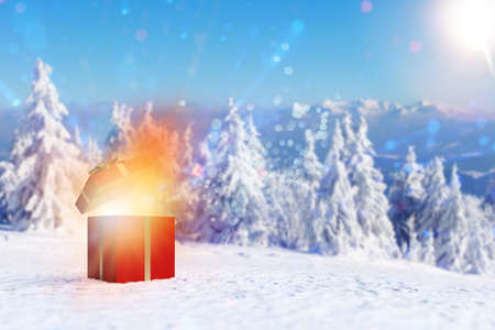 Red gift explodes at Christmas in a winter landscape (3D rendering) Imagens