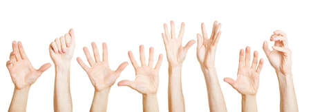 Many different hands reach up desperately