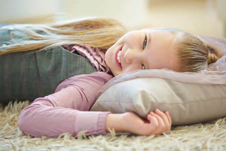 Girl lies on a pillow to relax