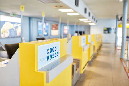 Row of empty check-in counters of airlines in airport terminal