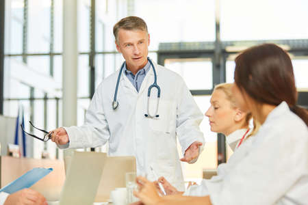 Senior doctor gives a speech or a speech in a seminar or a doctors meeting