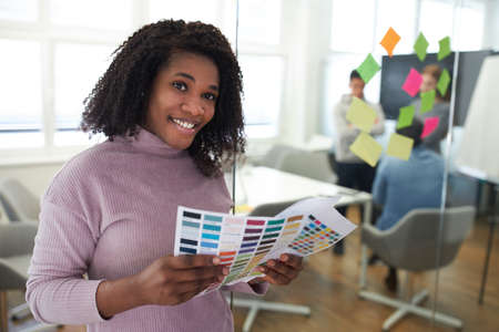 African business woman as a graphic designer in the color design of a website