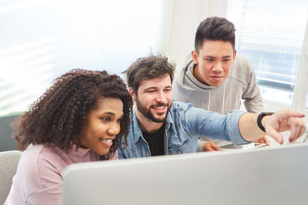 Web designer as a start-up team works together on a PC on a design project