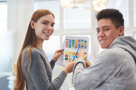 Creative graphic design team in the color selection with color palette for a customer project
