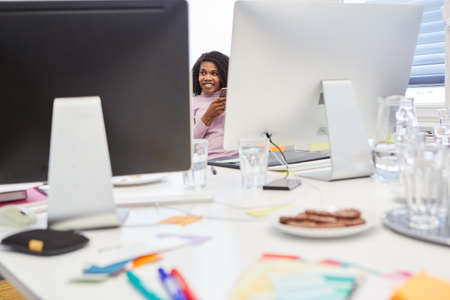 African business woman in internet agency office with computers on table