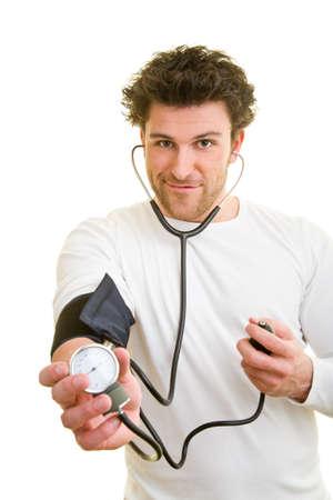 Young man measures his blood pressure himself