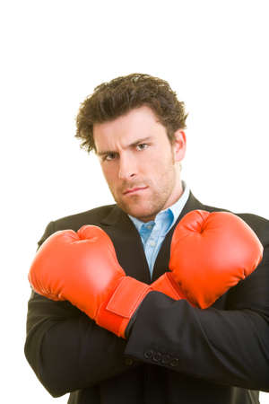 Young man in suit with red boxing gloves
