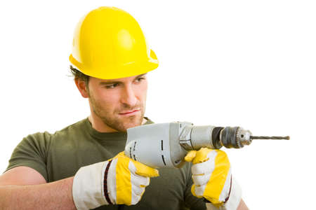 Construction worker with helmet and drill