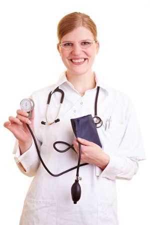 Blonde female doctor holding a blood pressure monitor Banco de Imagens
