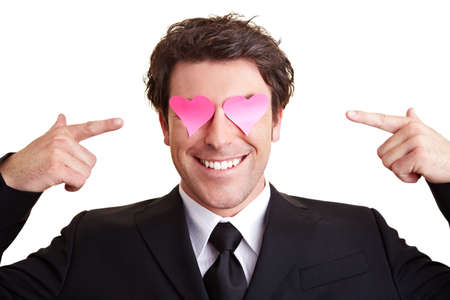 Manager with heart-shaped pink sticky notes in front of his eyes
