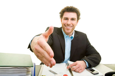 Young man at the desk extends his hand forward Stock Photo