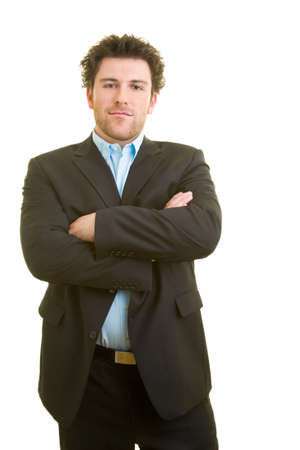 Young man in business clothes crosses his arms