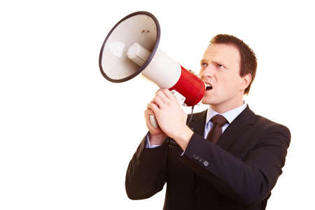 Businessman in a suit screaming into a megaphone