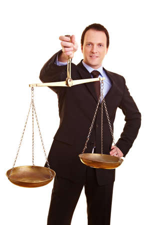 Businessman holding scales in his hand