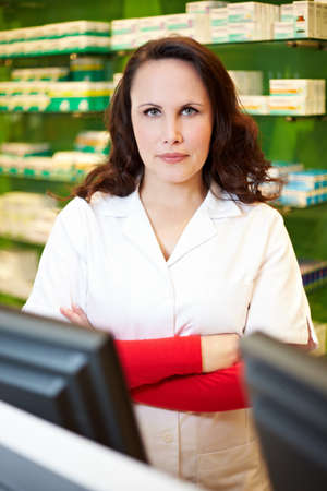First pharmacist crosses arms in pharmacy