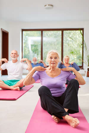 Seniors do exercise together in the physiotherapy rehabilitation course