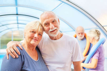 Amorous senior couple in a swimming pool after aquagym