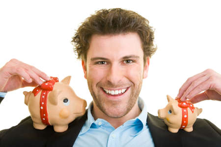 Young man in suit carries two piggy banks on his shoulders Stock Photo
