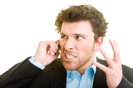 Young man in business attire is angry on his cellphone