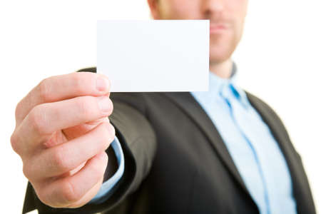 Young man in suit shows a blank business card