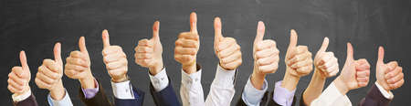 Many hands with thumbs up as a success concept Standard-Bild