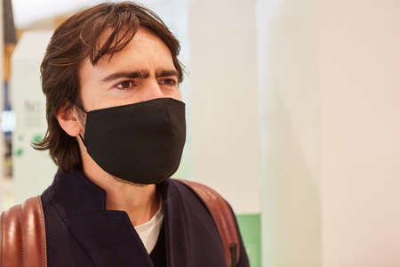 Customer or passer-by with face mask due to Covid-19 pandemic in the shopping center