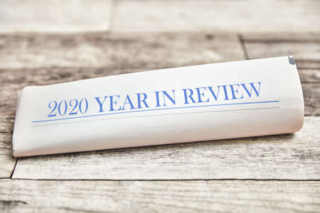 2020 Year in Review on a folded newspaper as the front page