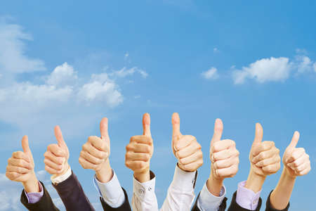 Business team under the sky with thumbs up
