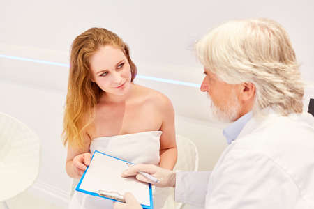 General practitioner or specialist in plastic surgery and patient consulting in a doctor's office