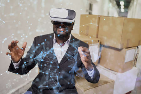 Network visualization by African businessman with virtual reality glasses 版權商用圖片